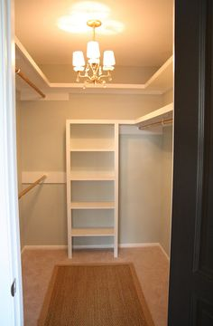 Love the chandelier in closet and love that the hanger rods are spray painted gold.