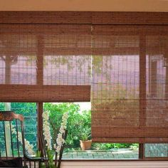 Blinds.com Brand Budget Woven Wood Shades in Penang Brown. Choose between a variety of rich textures and colors that will add natural warmth for an affordable price.