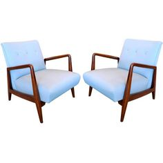 Pair of Jens Risom Walnut Frame Lounge Chairs  USA  1960's  A hard to find original pair of Jens Risom lounge chairs with sculptural walnut frames. Label 'Jens Risom Designs'.