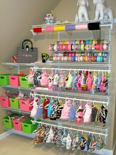 Pinner Says: NataleesCloset design studio. Closet shelving was used on a wall of the studio to hang garments and organize trim. The ribbon storage is actually shoe racks from Home Depot. It's a doggy closet Chloe needs one!-OPAWZ, this is perfect to Animal Room, Dog Closet, Dog Bedroom, Puppy Room, Dog Grooming Salons, Dog Grooming Shop, Ribbon Storage, Dog Rooms, Kids Rooms