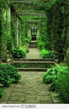 Pergola with stone walkway and water feature at Arundel Castle, England