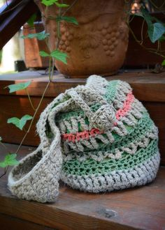 Small Boho handbag. Crocheted with natural hemp twine and 100% cotton fibers. Lined with fabric. Button is made with hemp twine.