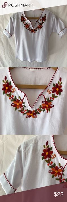 Girl's floral embroidered Mexican Huipil blouse. Adorable rust orange and red floral embroidered collar with tooling sewn at sleeve caps. Made in Guatemala, size XL. Sizing similar to US girls 7-8. Shirts & Tops Blouses