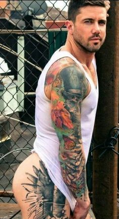 Attractive hunks in tats teasing