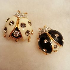 """Joan Rivers Ladybugs Brooches Set/2 Darling """"Day and Night"""" ladybugs made in Joan's classic style.  Black and creamy white enamel with crystals on gold-tone bases.  Both brooches are stamped on back.  Joan sure loved her insects; she wore them high near her shoulder for maximum impact ☺ These are collectible pieces, retired from her collection.   No Trades or PP Joan Rivers  Jewelry Brooches"""