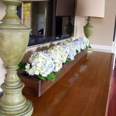How to Make an Indoor Flower Box {wood finishing}... I'm pinning this not only for the wood flower box, but also maybe a dresser instead of my ugly, boring, glass tv stand?  hmm.... garage sales!