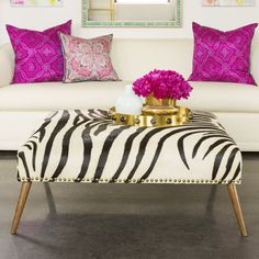 The Zebra Ottoman from Emporium Home is a great accent piece for any room.  Hide, Walnut Finish