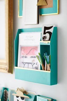 Paper Wall Organizer Maximize space and style with chic wall organizers. The gilded edges and divided compartments provide your dormitory with the perfect place to store makeup, school supplies and more. With all its compartments, this wall organizer does it all.