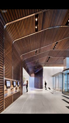 Walnut slats framed with bronze mark the lobby of the Hyatt Times Square New York by SPaN Architecture. Photography by Michael Moran/OTTO. Lobby Interior, Retail Interior, Interior Exterior, Interior Lighting, Interior Architecture, Parametric Architecture, Lobby Design, Ceiling Design, Wall Design