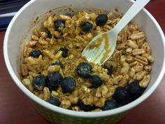 Pumpkin cocoa overnight oats with Pb stirred in and topped with puffed cereal & blueberries mmmm