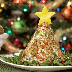 Chicken Salad Christmas Tree! Absolutely Delicious and Fancy enough to serve at your next party! Impress your friends with your creation! #Christmas #Appetizer #Salad #Holidays #ChickenSalad #Recipes #Cooking #CraftyCookingByAnna  FYI: cutting chicken on the newspaper print Parchment Paper!