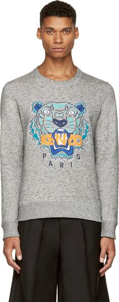 Long sleeve sweatshirt in heather grey. Slub effect throughout in black. Ribbed crewneck collar, cuffs, and hem. Signature tiger and logo embroidered at front in blue, teal, and orange. Fleecy interior. Tonal stitching.