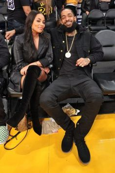 Celebrities At The Los Angeles Lakers Game Nipsey Hussle's untimely and tragic death leaves a void not only in hip-hop, but in the hearts of his family, friends and fans. The Victory Lap rapper was the father of two young children and… Black Love Couples, Matching Couples, Cute Couples Goals, Couple Goals, Family Goals, Celebrity Sneakers, Lauren London Nipsey Hussle, Dress Over Pants, Hip Hop