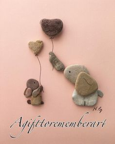 "65 mentions J'aime, 7 commentaires - Neshat Ghaffari (@agifttorememberart) sur Instagram : """"Elephant and bunny"" recreating a cute drawing with pebbles! #agifttorememberart #pebbleart…"""