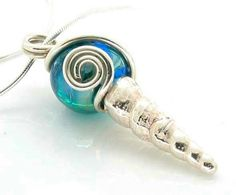 Silver shell pendant with glass bead