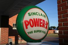 Sinclair sign at a restored gas station in Norton, Kansas. Photo by Neil Croxton