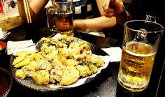 TWEEGIM (Fried foods) platter with Korean MAX beer @ SAK Bar in Ehwa Women's University Region, South Korea. Includes Fried squid, shrimp, Kimbab, Soondae, Mandoo (dumplings), sweet potatoes, and many more!