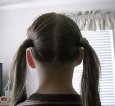 Low hair wrapped pigtails