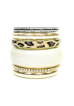 LEOPARD LUXE BANGLE SETLEOPARD LUXE BANGLE SET Mixed bangles set. A mix of seven gold, crystal and animal print bangles. Ivory/gold/leopard. 6932  Color:Size: Style #: 6932 Select a Qty $9.90