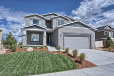 The #Jackson 2-story home with welcoming covered front porch, stucco and siding accents.