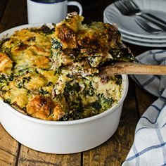Gruyère White Cheddar and Kale Strata aka: the best eggy cheesy bread-y thing ever. The perfect make-ahead breakfast for Christmas morning
