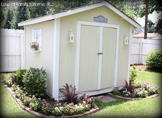Isn't this outdoor shed adorable.  I dream of having one like this.