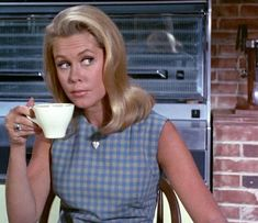 "Samantha's ""Don't talk to me before I finish this cup of coffee..."" look ♥ Elizabeth Montgomery in Bewitched"