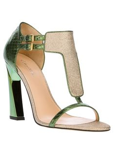 Green patent leather sandals from Calvin Klein Collection featuring an open toe, a gold-tone front panel, a double ankle strap with buckles, a snake-print panel to the back, a branded nude insole, a nude sole and a high curved heel.