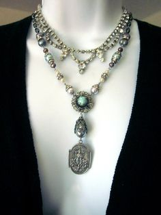 Religious Assemblage Necklace, Vintage Repurposed, Statement Necklace. $125.00, via Etsy.