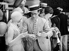 Ann Christy and Harold Lloyd enjoy a snack at Coney Island in Speedy, 1928 no 1 of 2