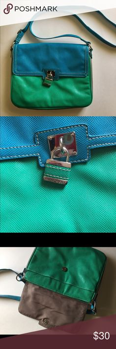 Nine West Colorblocked Crossbody Bag ONLY USED 2x!! 🎉 Nine West faux leather crossbody bag. Green, bright bluish teal, and grey colorblocking. Has magnetic clasp and two different pockets on the inside; lock detail on front says Nine West. Very gentle use and cute bag!!! Nine West Bags Crossbody Bags