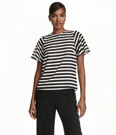 Black/white striped. CONSCIOUS. Straight-cut blouse in airy woven fabric with a…