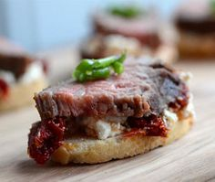 Spicy tomato, goat cheese and steak crostini