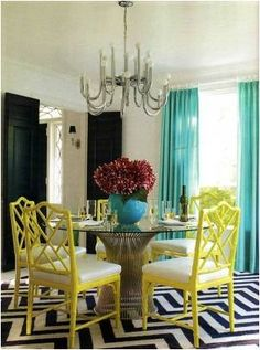 This is a little Palm Beachy for me, but I love the use of color and pattern.  The rug ends up being a neutral.
