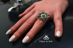 Silver filigree ring.
