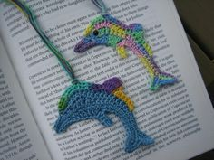Dolphins crochet bookmarks (finished crochet item) not a pattern or free, but I thought they were cute.