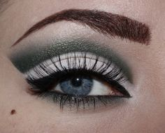 To see a step by step tutorial for this look go to: http://madamnoire.blogspot.com/2012/01/tutorial-green-and-white-cut-crease.html