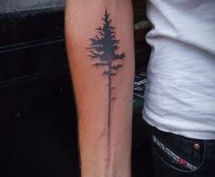 Tree tattoos are hot right now - this one is great for men