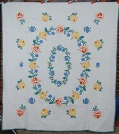NICELY QUILTED 1930's Rose Wreath Applique Antique Quilt! Ah,if I had an extra 600.00 or so sitting around..but id get no peace unless I sent cash to Heifer instead.$600.00 would buy alot of Honeybee hives for families in Guatamala.The more widely we distribute bees,the more likely it is that some might escape the scourge of Colony Collapse Disorder.We need our bees more than we need even very lovely treasures.Though this particular quilt is really of museum quality.