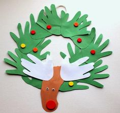 Reindeer Foot and Handprint Wreath   Hang up this adorable easy Christmas craft for kids. Handprints and footprints make a cute wreath!