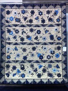 "Blue Mountain Daisy: The Craft and Quilt Fair - Part 2.  ""Indigo Daisies"" by Lynn Hewitt, grandmother's flower garden/hexagon variation quilt. 2011 Craft and Quilt Fair, Sydney, Australia."