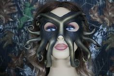THIS IS A HAND CRAFTED LEATHER KRAKEN MASK. THIS MASK HAS BEEN HAND CUT AND FORMED. PAINTED IN A BRONZY /GOLD COLOR. SEALED FOR PROTECTION. FOR MEN OR WOMEN. DISPLAYED ON A AVERAGE SIZE MANNEQUIN HEAD. EASY TO USE LEATHER FASTENING STRAPS. MY OWN CUSTOM SYNCH STRAPS. NO TYING INVOLVED. LIGHT WEIGHT AND COMFORTABLE. ALL MY MASK COME WITH HOW TO CARE FOR INSTRUCTIONS. CUSTOM ORDERS ARE ALWAYS WELCOMED.    Thanks for visiting our shop
