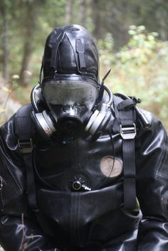 """hockeyjockfin: """" Happened in a nearby forest, not so long ago: Test subject has first inserted a plug, then donned a cup and rubber jocks. A thin catsuit with attached socks, gloves and a rubber hood. Women's Diving, Diving Suit, Scuba Diving Gear, Scuba Wetsuit, Hazmat Suit, Rubber Doll, Heavy Rubber, Diving Equipment, Rubber Gloves"""