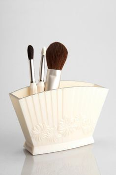 PAUL & JOE Brush Holder. Urban Outfitters. $23. Maybe a little on the expensive side - but still cute!