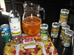 Mango Sangria: 1 bottle Pinot Grigio, 4 cans Mang-o-ritas, 1 can Lime-a-rita, 1 can Sprite, 2c. frozen mixed fruit w/ peaches. Refrigerate at least an hour.
