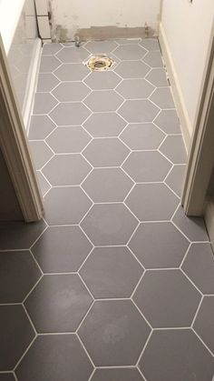 This modern boho bathroom remodel was definitely one for the books. Deciding to demo right before a deployment on top of being 6 months pregnant. The modern boho design is great for a guest bathroom and fun enough for a children's bathroom. Cheap Bathroom Flooring, Cheap Bathrooms, Bathroom Floor Tiles, Tile Floor, Bathroom Baseboard, Hexagon Tile Bathroom Floor, Modern Floor Tiles, Mosaic Bathroom, Marble Bathrooms