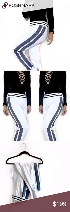 • Rag & Bone • Sammi Track Pant Rag & Bone Sammi knit pants with contrast side stripes. Striped waistband sits above hips. Relaxed legs taper at ankle. Ribbed cuffs. Pull-on drawstring waist. Nylon; nylon/rayon sides. Imported. rag & bone Pants Track Pants & Joggers