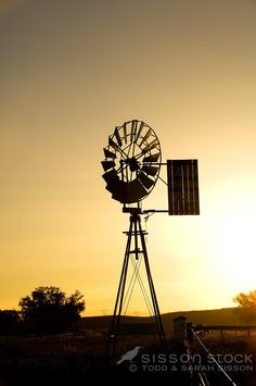 Windmill silhouetted in evening light Hayes Engineering Oturehua, ida valley on the Central Otago rail trail.  This is an historic places trust property.