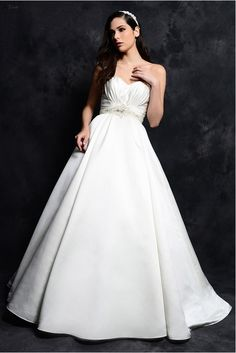 Classic gown is made in Royal Duchess Satin with  encrusted with crystallized beading A-line skirt chapel length train - http://www.aliexpress.com/item/Classic-gown-is-made-in-Royal-Duchess-Satin-with-encrusted-with-crystallized-beading-A-line-skirt-chapel-length-train/32340056670.html