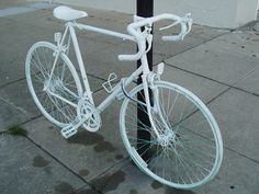 "Some times there are no words. These are ""Ghost Bikes"", placed as a memorial where a cyclist was killed."
